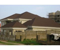 High quality and affordable stone coated step tile roofing sheets call Mike @ 08161505357